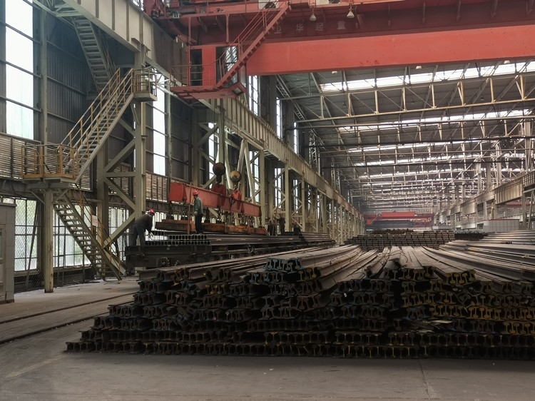What method can be used to increase the service life of steel rails?